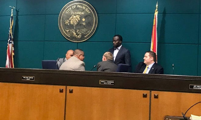 Palm Bay City Council members huddle prior to Thursday night's council meeting. This photo was taken by Tom Gaume.