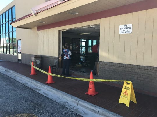 A driver mistakenly backed into the side of the Hibiscus Boulevard McDonald's Friday morning.