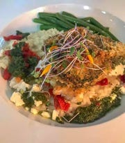 Pesto-crusted chicken is one of the creative entrees at Watermark Grille in Malabar.