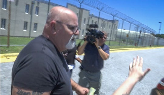 Dave Isnardi leaves the Brevard County Jail in May 17 after being granted bond.