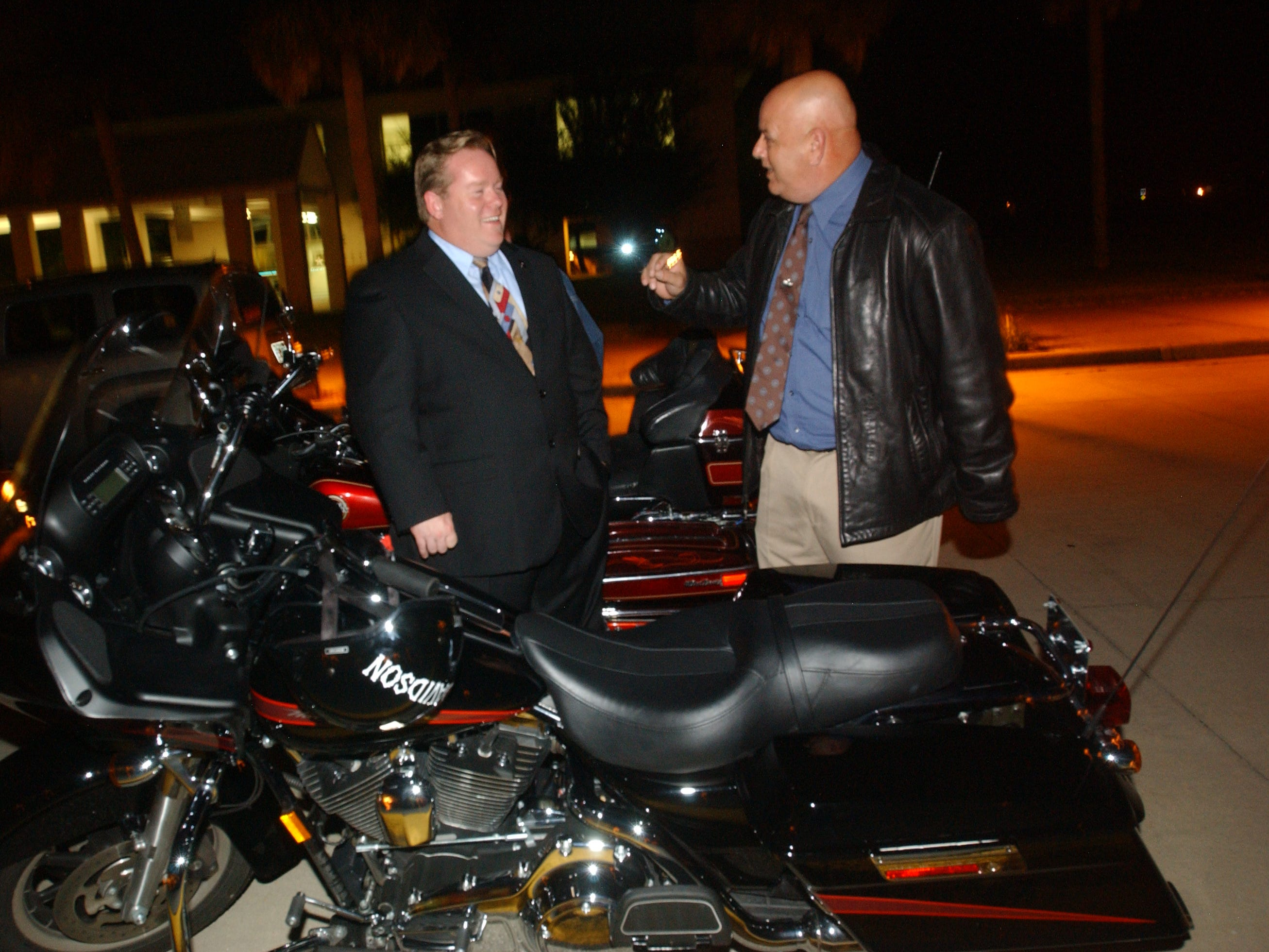 Andy Anderson, left, and Dave Isnardi visit together after the Brevard County Commission meeting.