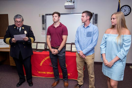 Corpus Christi Fire Chief Robert Rocha (from left) awards Zach Cuellar, Jake Simms and Jacqueline Paveglio with the department's Citizens Certificate of Merit during a ceremony at the Corpus Christi Fire Department Headquarters on Friday, May 17, 2019. The students saw a vehicle flip over and land on a man. They came to the aid of the man, turning the vehicle over and freeing the man, providing first aid and support until help arrived.