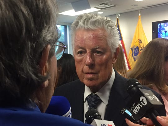 Former Gov. James Florio answers questions Thursday at an event praising Camden's progress and tax breaks.
