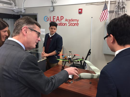 Federal Reserve Vice Chairman Richard Clarida (left) talks to Hung Nguyen about the drones he and his classmates at LEAP Academy are creating.