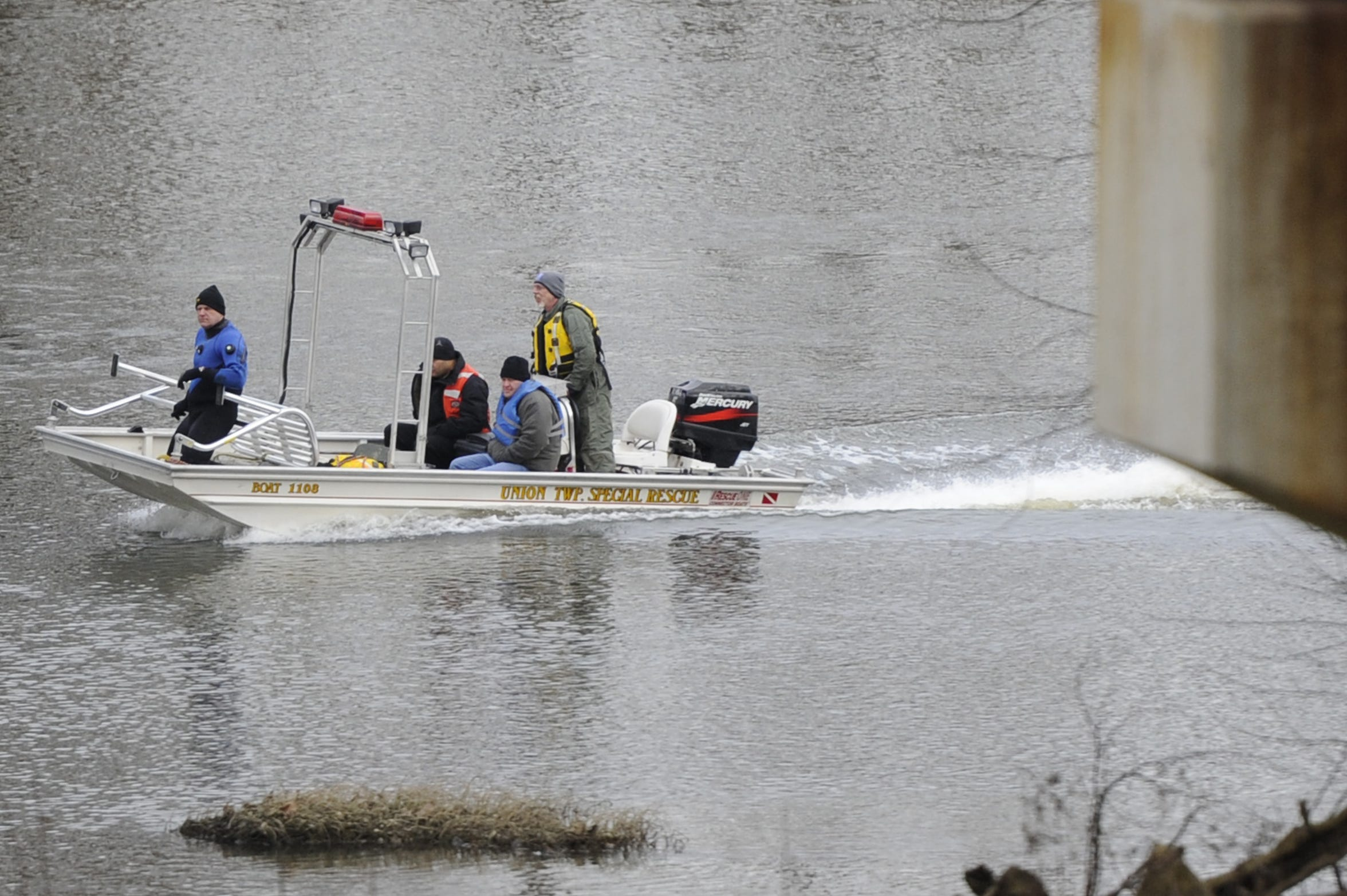 Investigators return to the boat launch after a body, later identified as Shasta Himelrick, was found and removed from the Scioto River on Jan. 2, 2015.