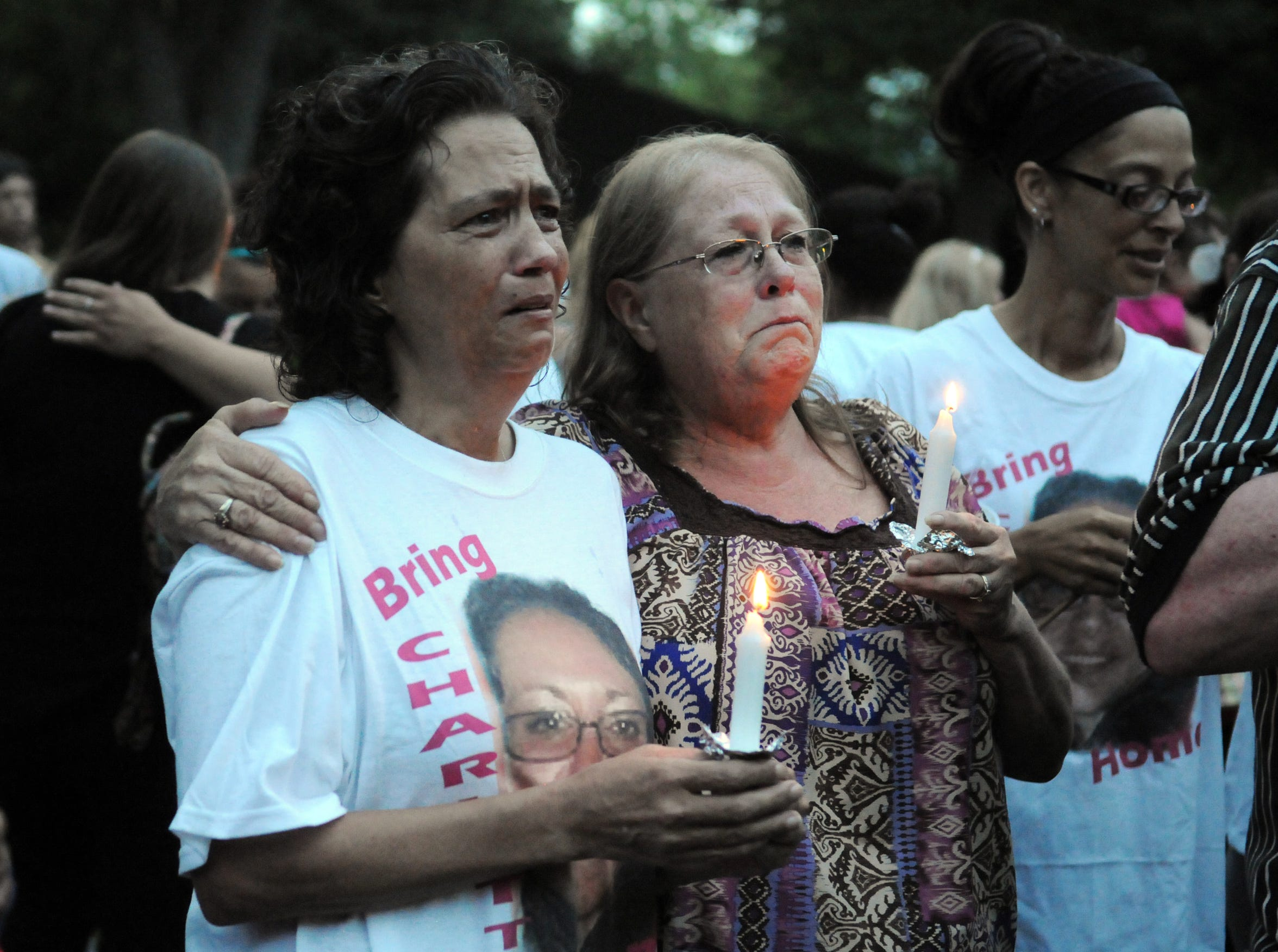 Lynnette Mitchell, right, hugs Angela Robinson, mother of Tameka Lynch, during a candlelight vigil on June 4, 2015, at Yoctangee Park.