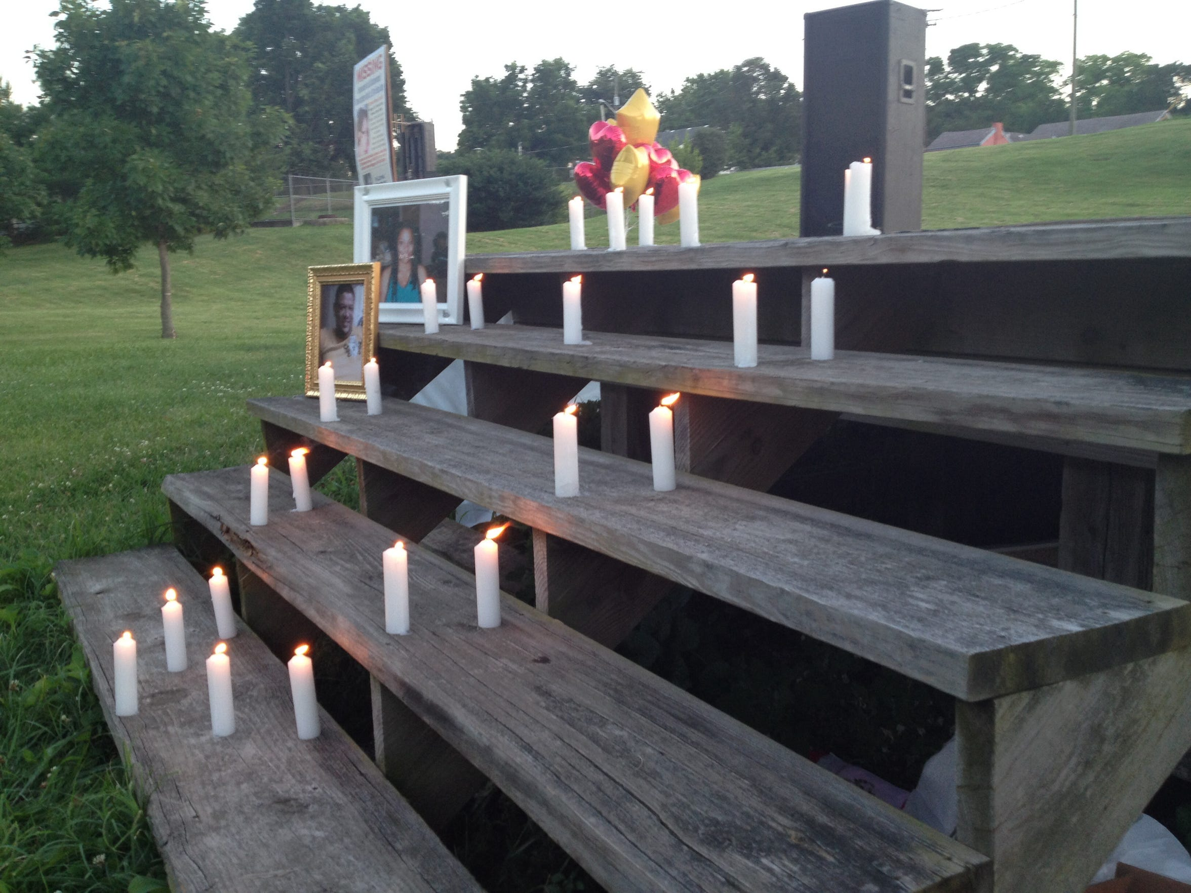 A picture of Tameka Lynch and several candles were placed to represent the unanswered questions still revolving around her death at a 2014 vigil.