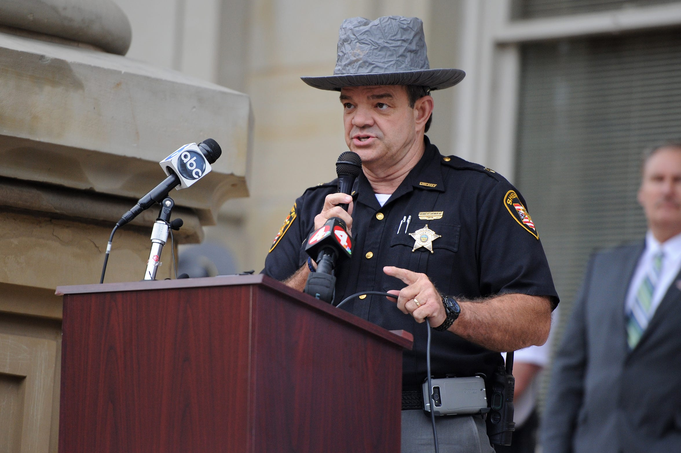 Ross County Sheriff George Lavender speaks during a 2015 rally where officials spoke about initiatives to make Chillicothe safer, to plea for people with information about the missing and murdered women to come forward and finally to march through the streets to raise community awareness.