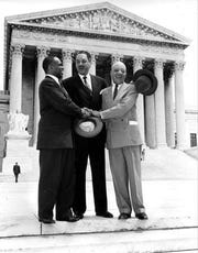 (Left to right) Lawyers George E.C. Hayes, Thurgood Marshall, and James M. Nabrit, Jr., celebrating outside the U.S. Supreme Court, Washington, D.C., after the court ruled in Brown v. Board of Education of Topeka that racial segregation in public schools was unconstitutional, May 17, 1954.