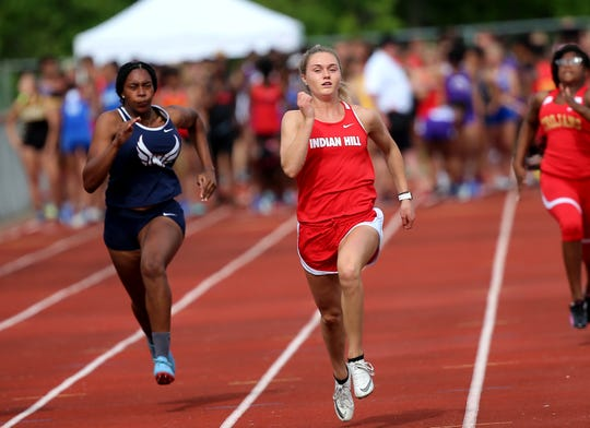 Anna Podojil of Indian Hill and Maddy Whitmore of Norwood compete in the DII district meet at New Richmond, Thursday, May 16,2019.