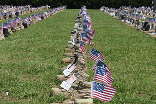 Some of the 7,600 boots on display at Fort Campbell as part of the Boots on the Ground display honoring fallen service members.