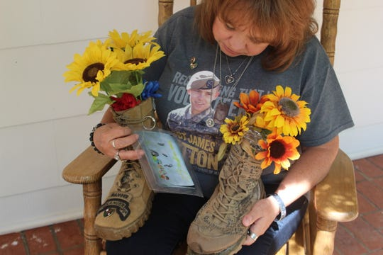 Sheila Patton examines a drawing made by her granddaughter which now decorates the boot of her son, Staff Sergeant James R. Patton, who was killed in action in Iraq on April 18, 2010.