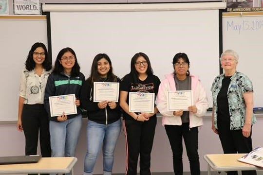 Left to right: Teacher Yesenia Infante, Ashley Garcia, Sarahi Lopez, Bernice Rojas-Rivera, Michelle Ortiz Merino and LHSNJ Editor Linda J. Barth pose for a picture.