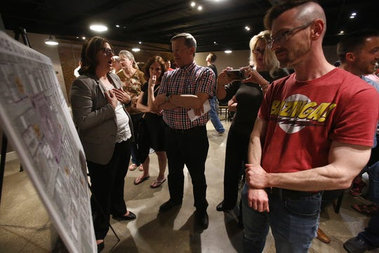 Indianola residents look over plans for the future of the Indianola Square developed by consultants Bolten & Menk. City officials held a May 15 public meeting about the future of the Indianola Square.