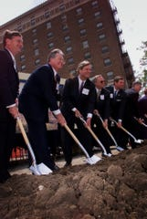 Galen Barnes, president of Nationwide Insurance; Steve Rasmussen, president of Allied Insurance; Gov. Tom Vilsack; Gene Phillips, chairman of the Polk County Board of Supervisors; Jerry Jurgensen, chief executive officer of Nationwide; and Mike Blouin, president of the Greater Des Moines Partnership, participate in a groundbreaking ceremony for the Nationwide corporate campus in downtown Des Moines in 2001.
