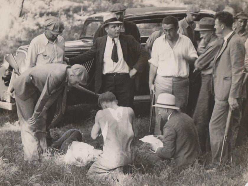 Marvin Barrow is surrounded by officers and deputies as he lay on ground at edge of Dexfield park, just after the capture. Barrow was shot through the head with a machine gun. This photo was originally published on July 24, 1933.For more historical Iowa photos, subscribe to the Register here:http://bit.ly/2KZwECu