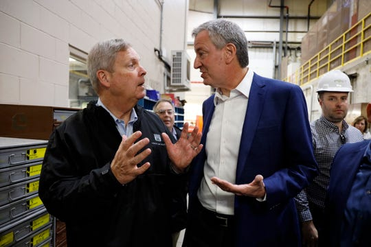 Democratic presidential candidate New York Mayor Bill de Blasio tours the POET Biorefining Ethanol Facility with former Secretary of Agriculture Tom Vilsack, left, Friday, May 17, 2019, in Gowrie, Iowa. De Blasio entered the 2020 race on Thursday.