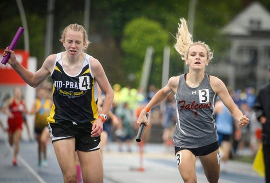 Mid-Prairie junior Marie Hostetler, left, edges Aplington-Parkersburg junior Sophia Jungling as the two anchors cross the finish line in the Class 2A distance medley event during the 2019 Iowa high school track and field state championships at Drake Stadium in Des Moines on Friday, May 17, 2019.