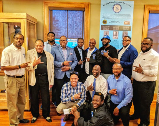 Members of Phi Beta Sigma Fraternity pose with the new display unveiled at Fort Des Moines Museum and Education Center. The display honors members of the fraternity who received their commissions at Fort Des Moines in 1917 and served in World War I.