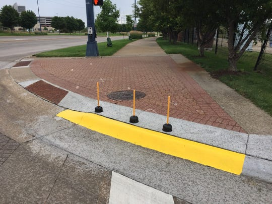 Unknown persons decided to make a curb at the intersection of Martin Luther King Jr. Parkway and Southwest 16th Street more visible after several cyclists crashed into it in 2017.