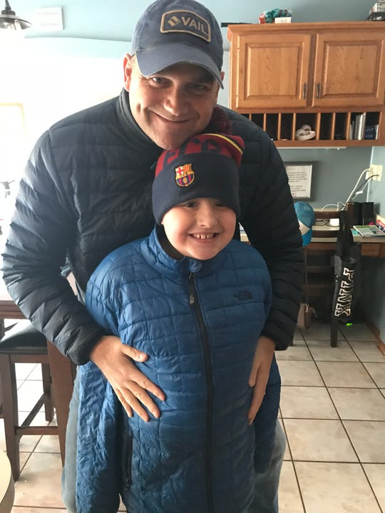 Former Michigan kicker Jeff DelVerne with his son, Colt, in February 2018. Colt died of DIPG, a cancerous brain tumor, in November 2018.