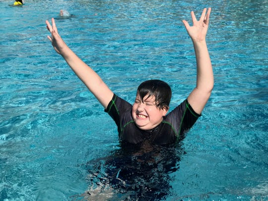Colt DelVerne swims while on vacation in Orlando, Fla., in January 2018. He died of DIPG, a cancerous brain tumor, in November.