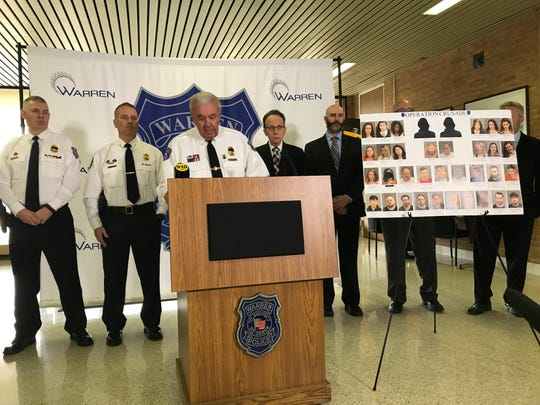 Warren Police Commissioner Bill Dwyer, center, stands with Mayor Jim Fouts and other police officials to discuss a three-day human sex trafficking crackdown in Warren during a news conference on May 17, 2019.