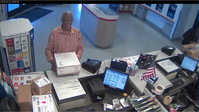 Surveillance footage from a post office shows Neil Thomas of Lansing mailing a package containing fentanyl and cocaine, according to federal prosecutors.