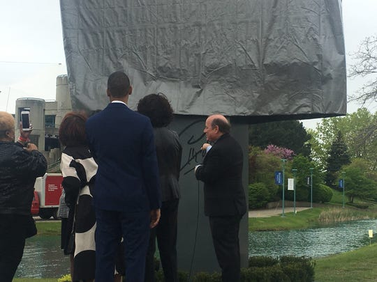 Detroit Mayor Mike Duggan taking off the cover to unveil the marquee for the renamed Aretha Franklin Amphitheatre.