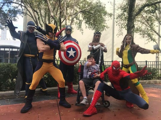Colt DelVerne poses with the Avengers at Universal Studios in Orlando, Fla. DelVerne died of DIPG, a brain tumor, in November 2018.