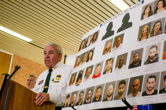 Warren Police Commisioner William Dwyer speaks at a press conference Friday announcing the dismantling of a prostitution ring in Warren hotels, at the Warren City Police Department.
