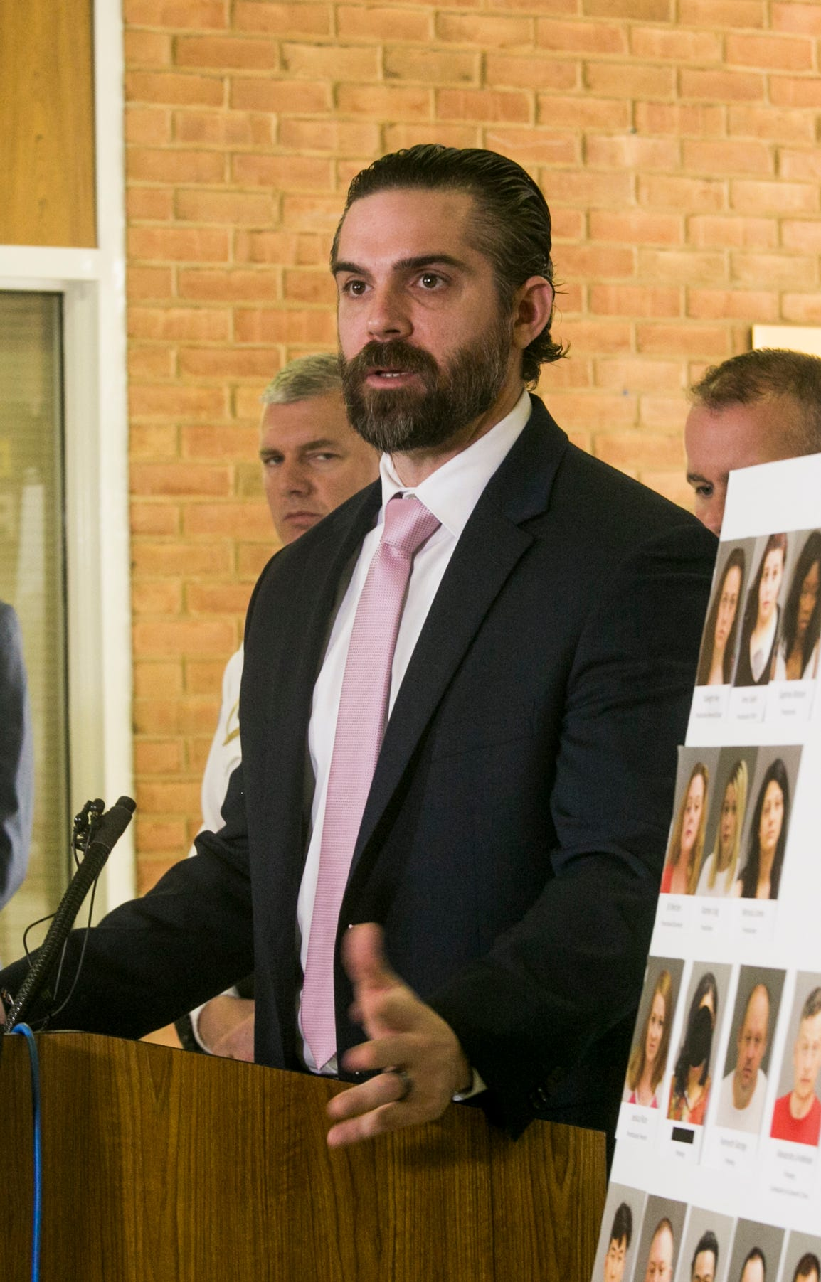Warren Police Detective Craig Bakawoski speaks at a press conference Friday announcing the dismantling of a prostitution ring in Warren hotels.