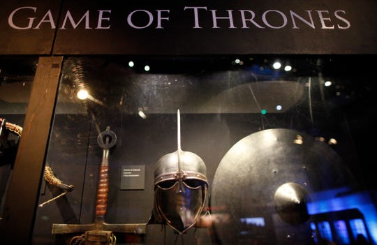 "In this is June 10, 2014 file photo of weapons from the ""Game of Thrones"" are displayed at the Waterfront Hall, Belfast, Northern Ireland."
