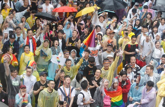 Same-sex marriage supporters cheer outside the Legislative Yuan Friday, May 17, 2019, in Taipei, Taiwan after the legislature passed a law allowing same-sex marriage in a first for Asia. T