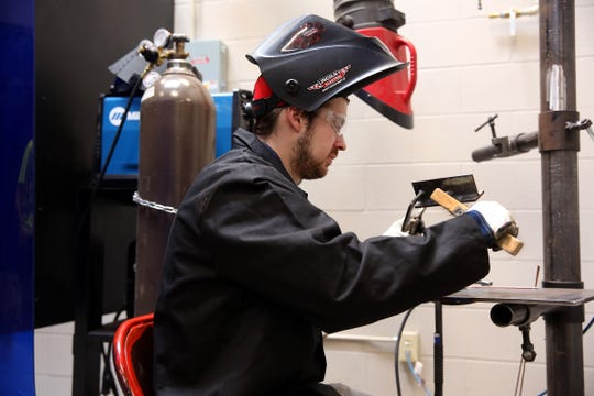 Charles Kelly, 27, of Kalamazoo works on a welding project at the Wayland Carpenter and Millwright Training Center in Wayland, Michigan.