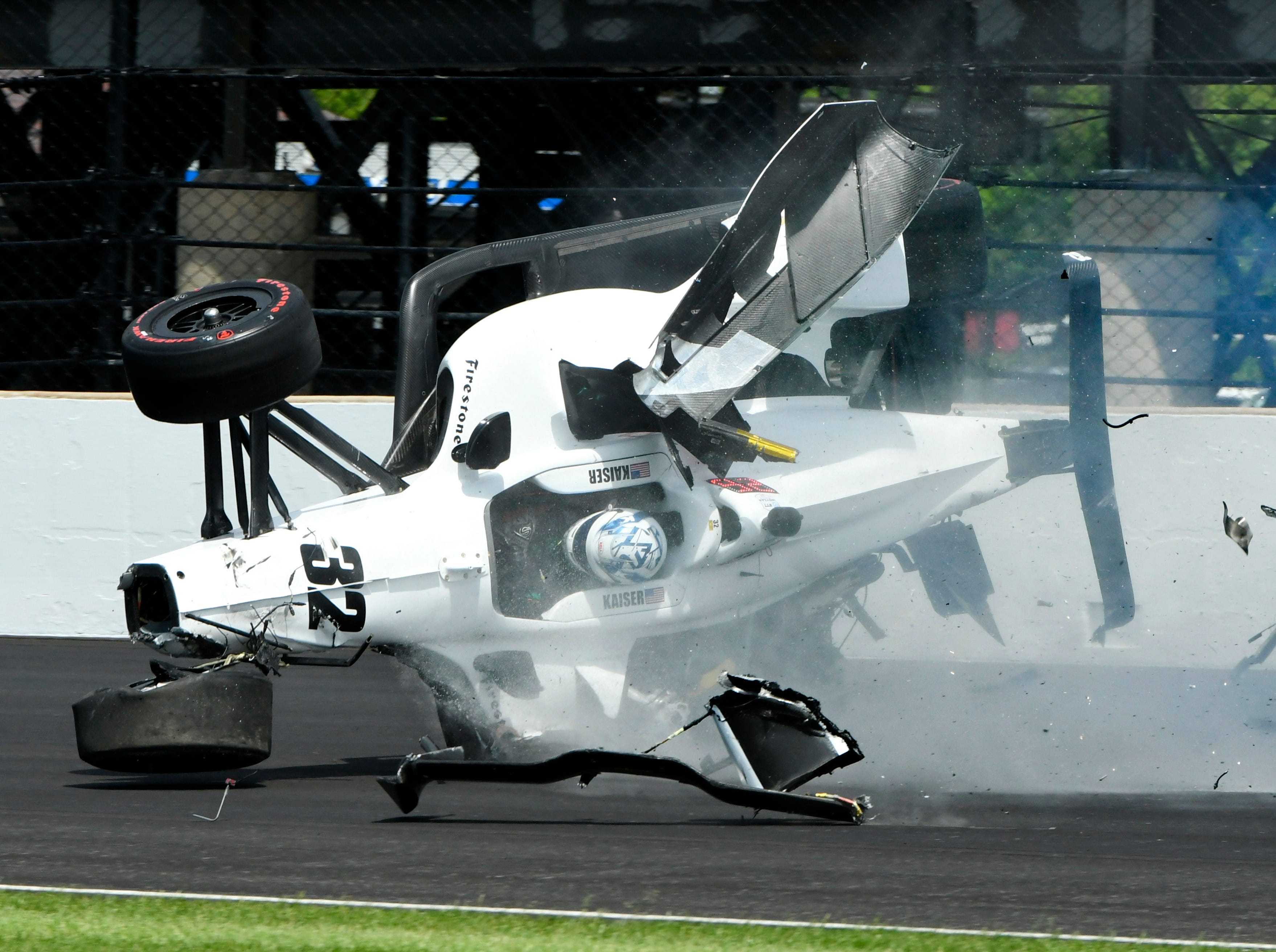 The car driven by Kyle Kaiser goes airborne after hitting the wall on the third turn during practice for the Indianapolis 500 IndyCar at Indianapolis Motor Speedway, Friday, May 17, 2019 in Indianapolis.