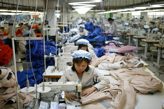 North Korean workers assemble jackets at a factory of a South Korean-owned company at the jointly-run Kaesong Industrial Complex, in Kaesong, North Korea.