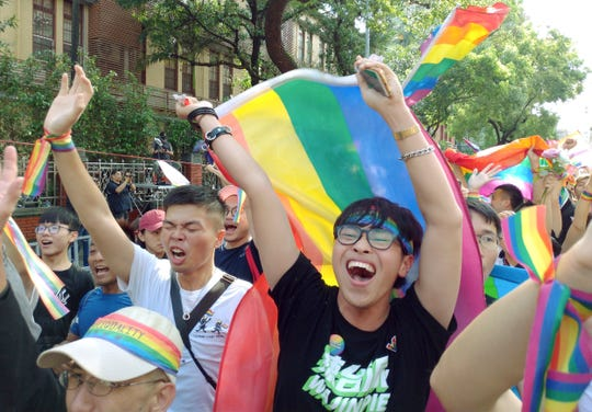 Same-sex marriage supporters cheer outside the Legislative Yuan Friday, May 17, 2019, in Taipei, Taiwan. The vote Friday allows same-sex couples full legal marriage rights, including in areas such as taxes, insurance and child custody.