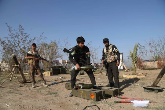 In this March 15, 2015 file photo, young Shiite volunteer militia members prepare to attack Islamic State fighters in Tikrit, north of Baghdad, Iraq.
