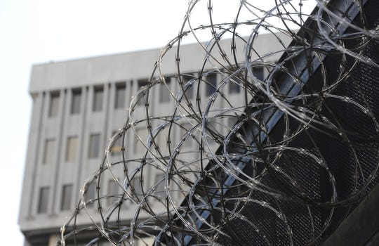 Razor wire tops a wall at the old Wayne County Jail in downtown Detroit.