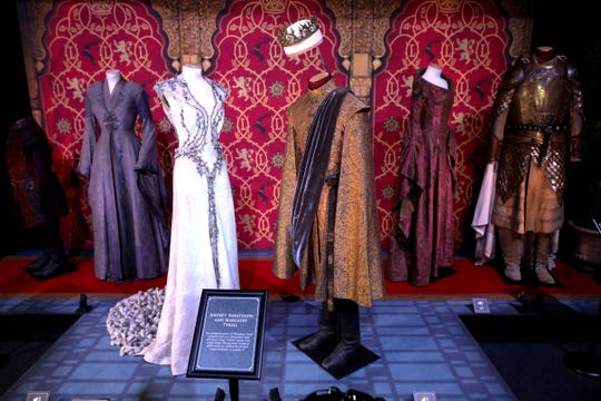 In this April 10, 2019, file photo costumes of the characters Joffrey Baratheon and Margaery Tyrell on display during the launch of The Game of Thrones Touring Exhibition at the Titanic Exhibition centre in Belfast, Northern Ireland.