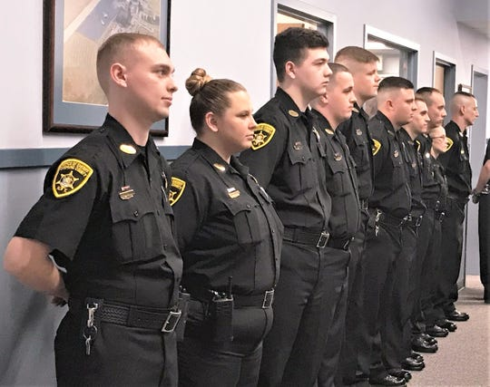 Ten Chemung County corrections officers who completed a training academy line up for a graduation ceremony Friday.