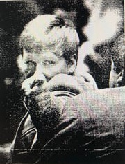 Jeffrey Lynn Hand shouts at a photographer trying to take his picture during his October 1973 murder trial. He was found not guilty by reason of insanity. He was recently named the killer in a Terre Haute cold case.