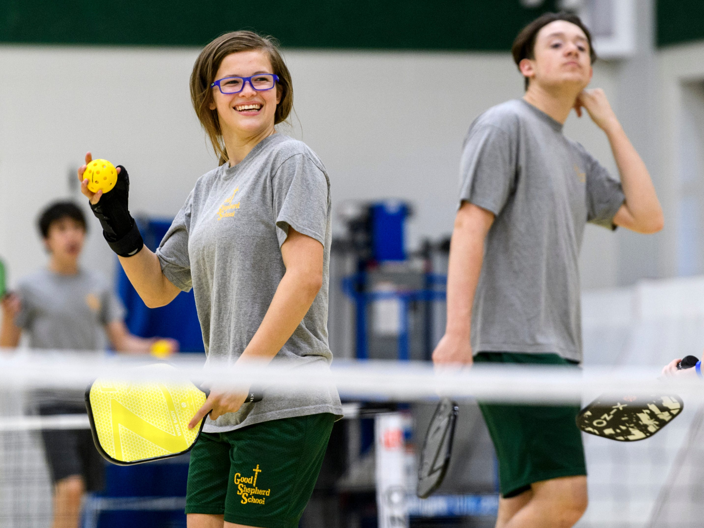 Kaylie laughs as she plays Pickleball with her fellow eighth grade classmates during gym class at Good Shepherd Catholic School in Evansville, Wednesday morning, May 15, 2019.