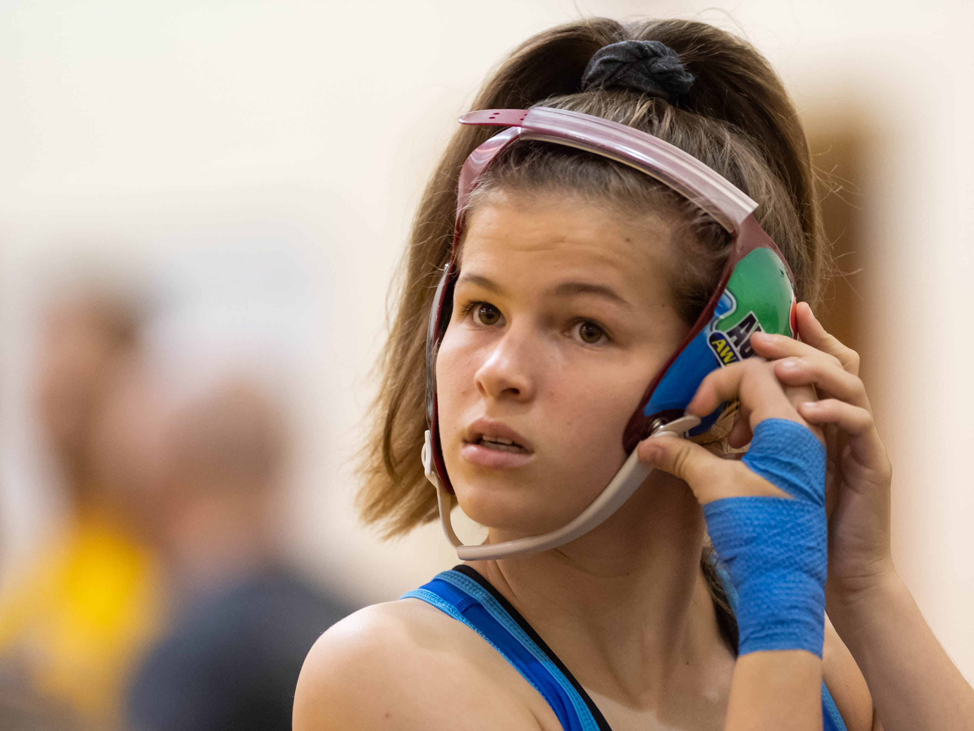 Kaylie prepares to compete in an exhibition match against senior Ciera Broukal, not pictured, following the Indiana State Wrestling Association Women's Freestyle State tournament at Avon High School in Avon, Ind., Sunday morning, May 5, 2019. After automatically winning her weight class, Kaylie's mother Rachel arranged for her to wrestle Broukal to get more practice on the mat.