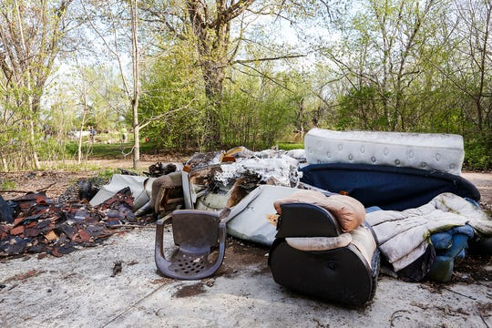 A pile of junk sits near where people fish Thursday, May 16, 2019 on the west side of Lake Winnebago off Lakeshore Drive.
