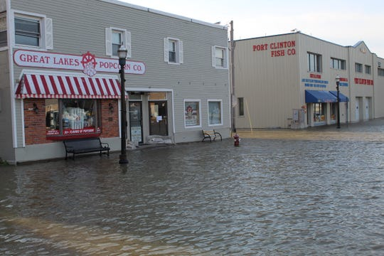 Parts of Madison Street were under water on Sunday as rain and winds caused flooding in downtown Port Clinton.