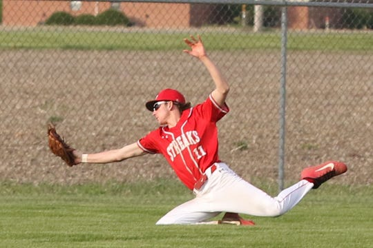 St. Joseph Central Catholic's Brody Deck makes a diving catch in the top of the seventh inning.