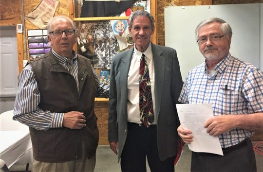 From left, Peter Navarre descendant Terry Breymaier, speaker Larry Michaels, and Ottawa County Historical Society president Patrick O'Keeffe at the OCHS Spring Meeting at the Elmore  Historical Society venue, The Barn.