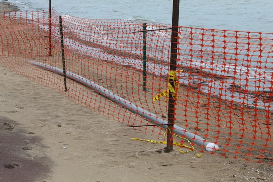 Severe erosion at Port Clinton City Beach has exposed a high voltage power conduit. The city closed the beach indefinitely Thursday as part of a state of emergency declaration.